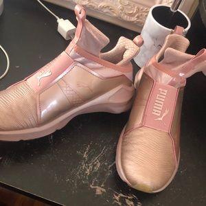 Kylie Jenner pink puma shoes.